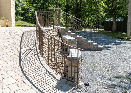 Artist-blacksmith entrance railing, view of right ramp