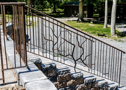 Artist-blacksmith entrance railing - stair view