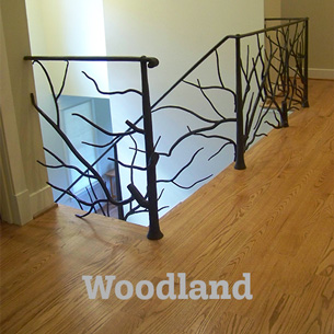 Artist-blacksmith stair railing with forged tree branches